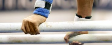 Gymnasts Holding Bar