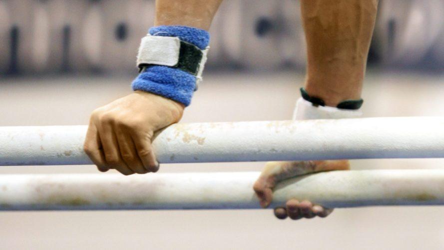 Gymnasts Holding Bar